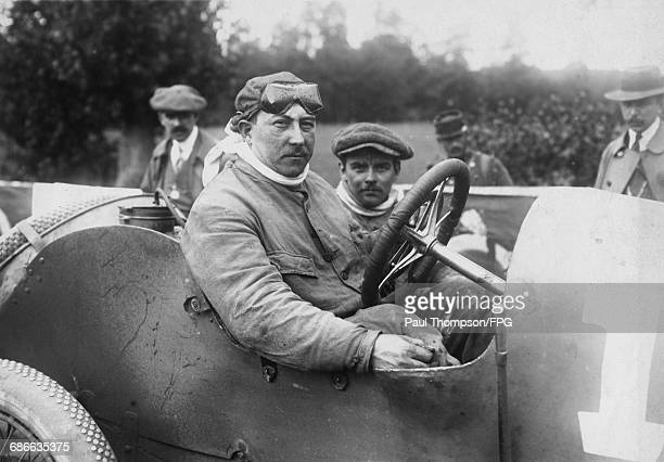 Rene Champoiseau of France and his riding mechanic aboard the Automobiles Theophile Schneider for the I Coupe de la Sarthe voiturette race on 9...