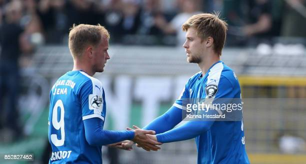 Rene Eckardt and Dominik Bock of Jena during substitudes during the 3Liga match between FC Carl Zeiss Jena and SC Preussen Muenster at ErnstAbbe...