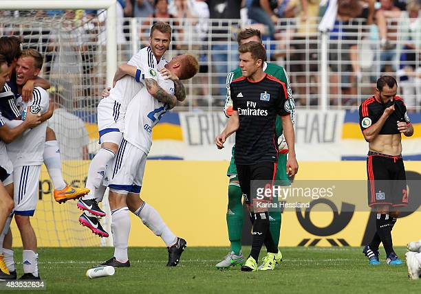 Rene Eckardt Rene Klingbeil and Justin Gerlach of Jena celebrate the victory Sven Schipplock and Marcelo Diaz of Hamburger SV look dejected after the...