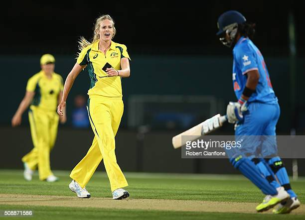 Rene Farrell of Australia celebrates after taking the wicket of Shikha Pandey of India during game three of the one day international series between...
