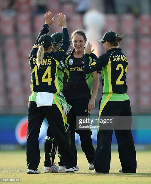 Rene Farrell of Australia celebrates dismissing Sarah Taylor of England during the Women's ICC World Twenty20 India 2016 Semi Final between England...