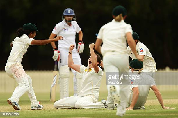 Rene Farrell of Australia celebrates with Lisa Sthalekar and other team mates after taking a hattrick with the wicket of Danielle Hazell of England...