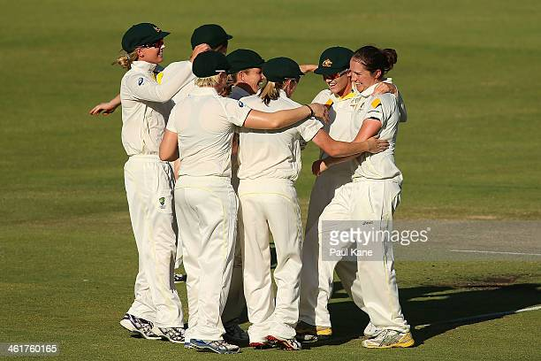 Rene Farrell of Australia celebrates with team mates the wicket of Heather Knight of England during day two of the Women's Ashes Test match between...