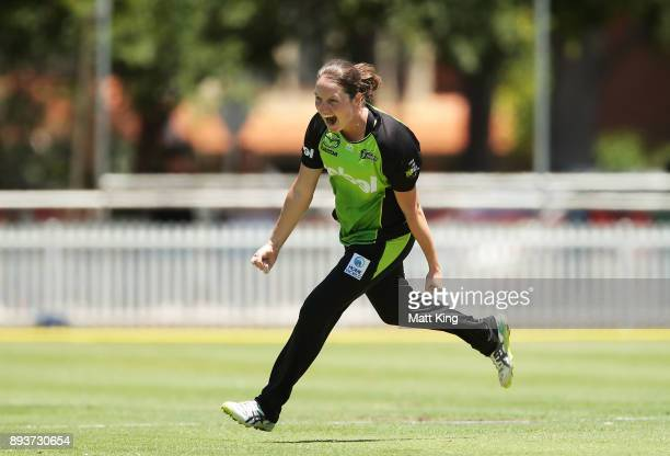 Rene Farrell of the Thunder celebrates taking the wicket of Lizelle Lee of the Stars with the first ball of the innings during the Women's Big Bash...