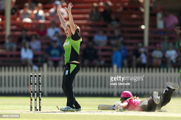 Rene Farrell of the Thunder celebrates the runout of Ellyse Perry of the Sixers by Alex Blackwell of the Thunder during the Women's Big Bash League...