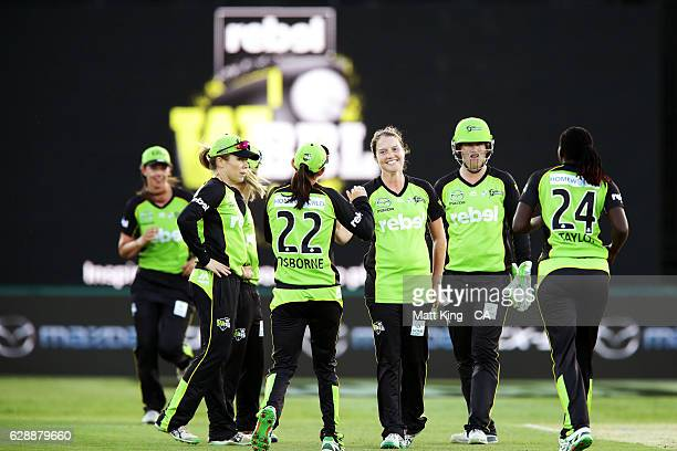 'SYDNEY AUSTRALIA DECEMBER 10 Rene Farrell of the Thunder celebrates with team mates after taking the wicket of Katie Mack of the Stars during the...