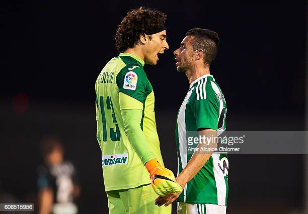 Rene Francisco Guillermo Ochoa of Granada CF argues with Ruben Castro of Real Betis Balompie during the match between Real Betis Balompie vs Granada...