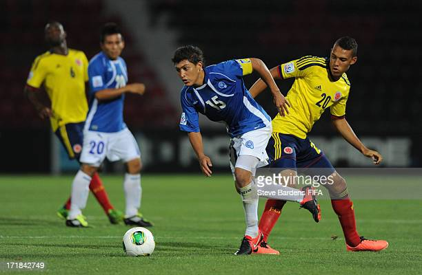 Rene Gomez of El Salvador breaks away from Brayan Perea of Colombia during the FIFA U20 World Cup Group C match between El Salvador and Colombia at...