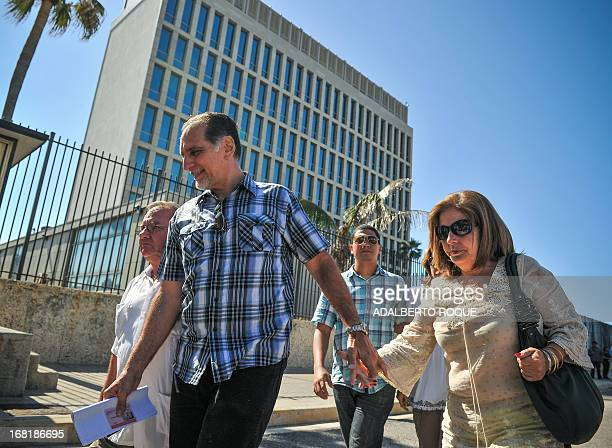Rene Gonzalez one of the Cuban Five group convicted of espionage in the United States leaves the US Interest Section with his wife Olga Salanueva on...