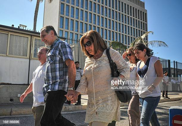 Rene Gonzalez one of the Cuban Five group convicted of espionage in the United States leaves the US Interest Section with his wife Olga Salanueva and...