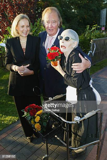 Rene Kollo and Beatrice Bouquet arrive at the restaurant variety show Pomp Duck and Circumstance on the premiere night September 2 2004 in Berlin...