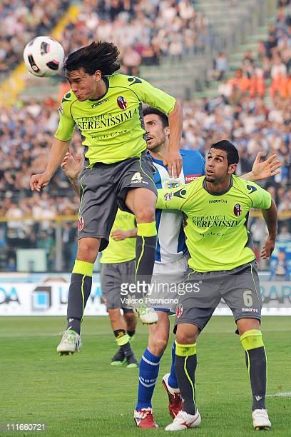 Rene Krhin of Bologna FC in action against Andrea Caracciolo of Brescia Calcio during the Serie A match between Brescia Calcio and Bologna FC at...