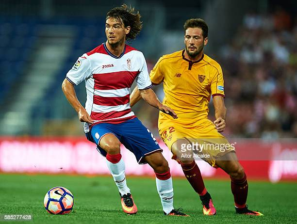 Rene Krhin of Granada FC being followed by Franco Vazquez of Sevilla FC during a friendly match between Granada FC and Sevilla FC at Estadio Nuevo...