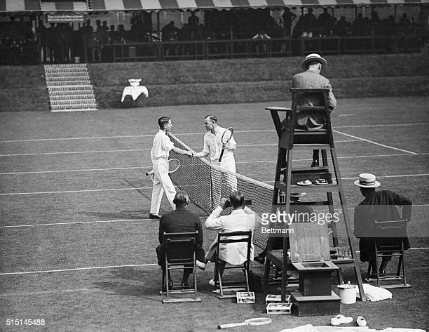 Rene Lacoste of France congratulating Gerald Patterson of Australia after the Davis Cup singles match