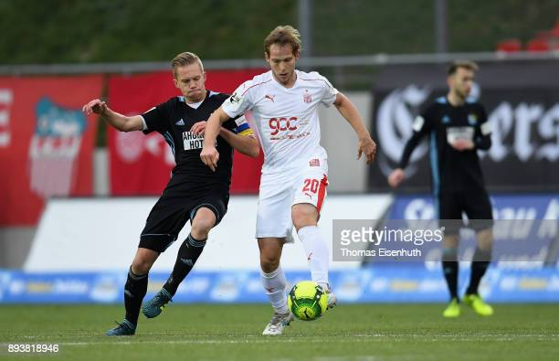 Rene Lange of Zwickau is challenged by Dennis Grote of Chemnitz during the 3 Liga match between FSV Zwickau and Chemnitzer FC at Stadion Zwickau on...