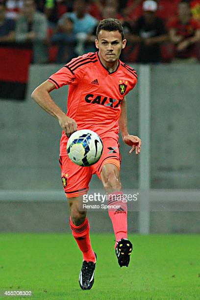 Rene of Sport Recife competes for the ball during the Brasileirao Series A 2014 match between Sport Recife and Santos at Arena Pernambuco on...