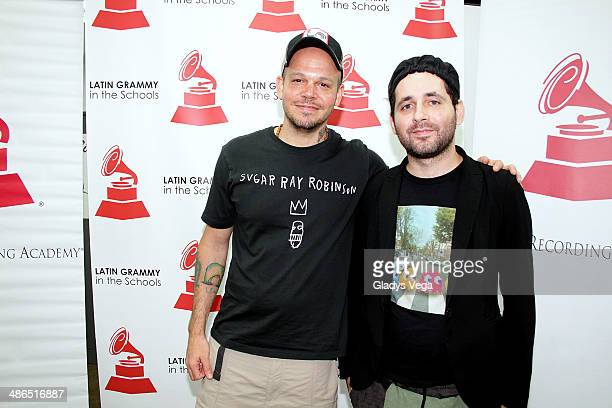 Rene Perez and Eduardo Cabra of Calle 13 attend 'Latin GRAMMY In The Schools' at Escuela Especializada en Bellas Artes Pablo Casals on April 24 2014...