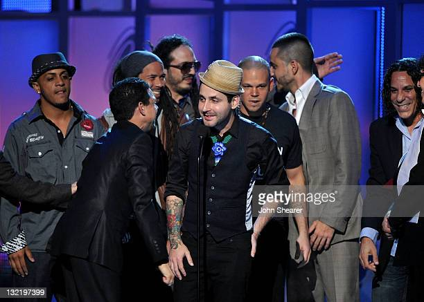 Rene Perez Joglar and Eduardo Cabra Martonez of Calle 13 accept the Album of the Year award onstage at the 12th Annual Latin GRAMMY Awards held at...