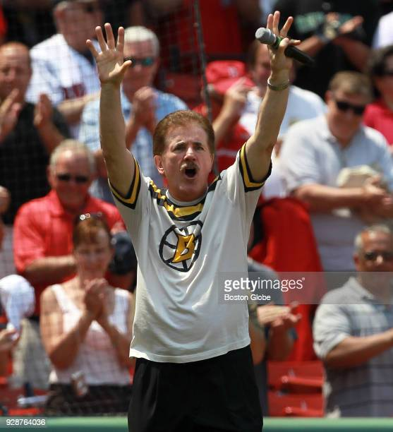 Rene Rancourt greets the fans after singing the National Anthem before the Boston Red Sox play the Chicago White Sox at Fenway Park in Boston on May...