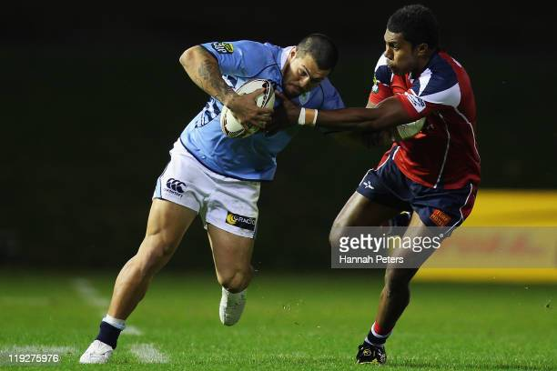 Rene Ranger of Northland fends off Willie McGoon of Tasman during the round one ITM Cup match between Northland and Tasman at Toll Stadium on July 16...