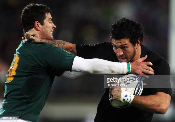 Rene Ranger of the All Blacks fends off Morne Steyn of the Springboks during the TriNations match between the New Zealand All Blacks and South...