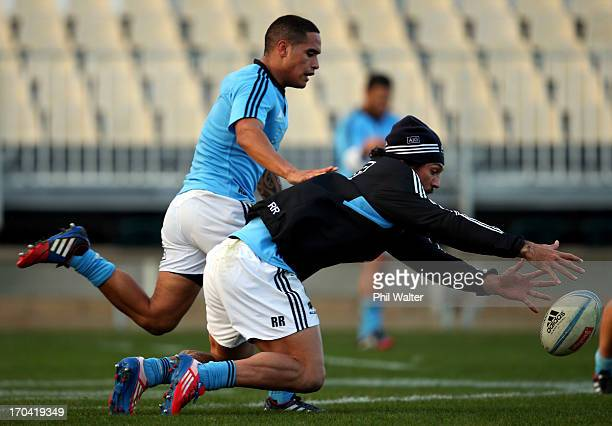 Rene Ranger of the All Blacks gets to the ball ahead of Aaron Smith during a New Zealand All Blacks training session at AMI Stadium on June 13 2013...