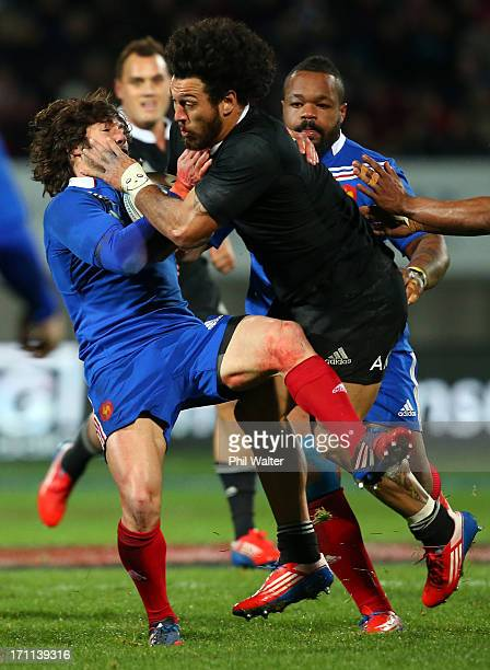 Rene Ranger of the All Blacks is tackled by Yoann Huget of France during the Third Test Match between the New Zealand All Blacks and France at Yarrow...