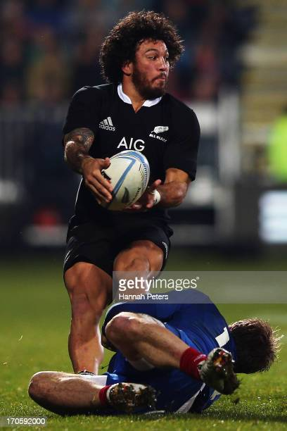 Rene Ranger of the All Blacks offloads the ball during the International Test match between the New Zealand All Blacks and France at AMI Stadium on...