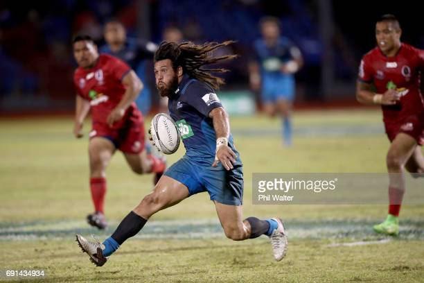 Rene Ranger of the Blues breaks away during the round 15 Super Rugby match between the Blues and the Reds at Apia Park National Stadium on June 2...