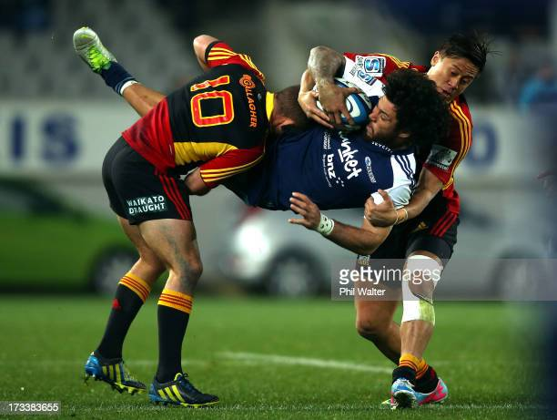 Rene Ranger of the Blues is dumped by Aaron Cruden and Tim Nanai-Williams of the Chiefs during the round 20 Super Rugby match between the Blues and...