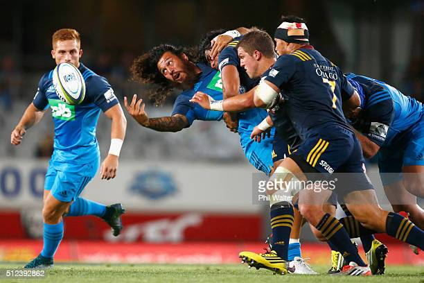 Rene Ranger of the Blues offloads the ball during the round one Super Rugby match between the Blues and the Highlanders at Eden Park on February 26...