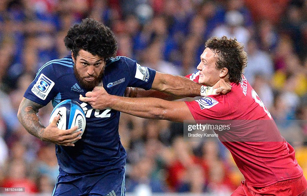 Rene Ranger of the Blues pushes away from the defence during the round 11 Super Rugby match between the Reds and the Blues at Suncorp Stadium on April 26, 2013 in Brisbane, Australia.