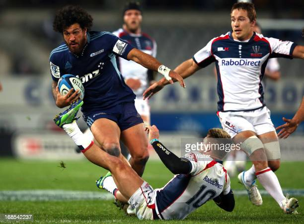 Rene Ranger of the Blues runs rampant over James O'Connor of the Rebels during the round 13 Super Rugby match between the Blues and the Western Force...
