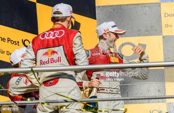 Rene Rast of Audi celebrates winning the championship with teammate Matthias Ekstroem of Audi during the DTM 2017 German Touring Car Championship at...