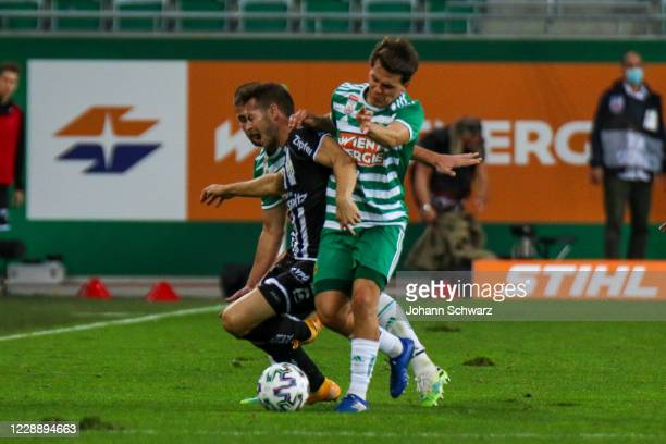 Rene Renner of LASK and Thomas Murg of Rapid during the tipico Bundesliga match between SK Rapid Wien and LASK at Allianz Stadion on October 4 2020...
