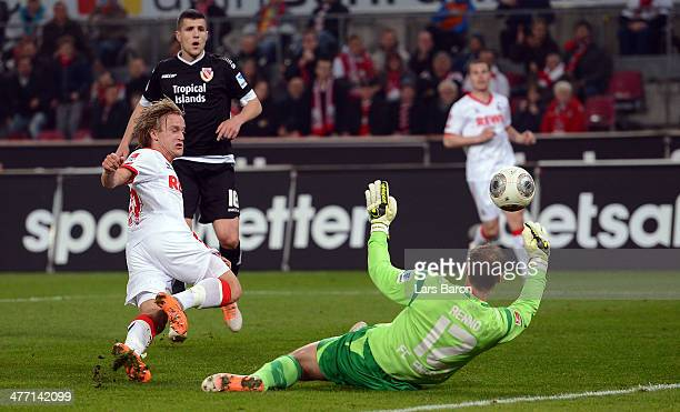 Rene Renno of Cottbus saves a shot of Bard Finne of Koeln during the Second Bundesliga match between 1 FC Koeln and Energie Cottbus at...