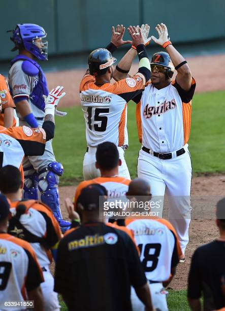 Rene Reyes of Aguilas del Zulia of Venezuela celebrates his home run against Tigres del Licey of the Dominican Republic during the Caribbean Baseball...