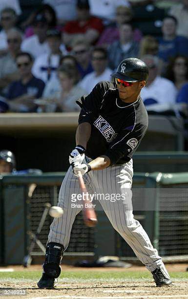Rene Reyes of the Colorado Rockies bats during the game against the Kansas City Royals on March 7 2004 at Surprise Stadium in Surprise Arizona The...