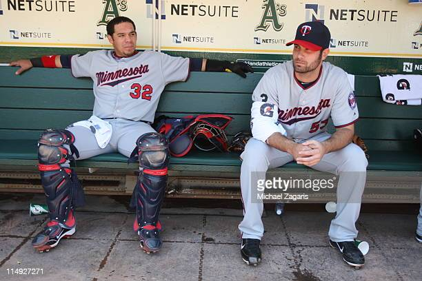 Rene Rivera and Nick Blackburn of the Minnesota Twins hang out in the dugout before the game against the Oakland Athletics at the OaklandAlameda...