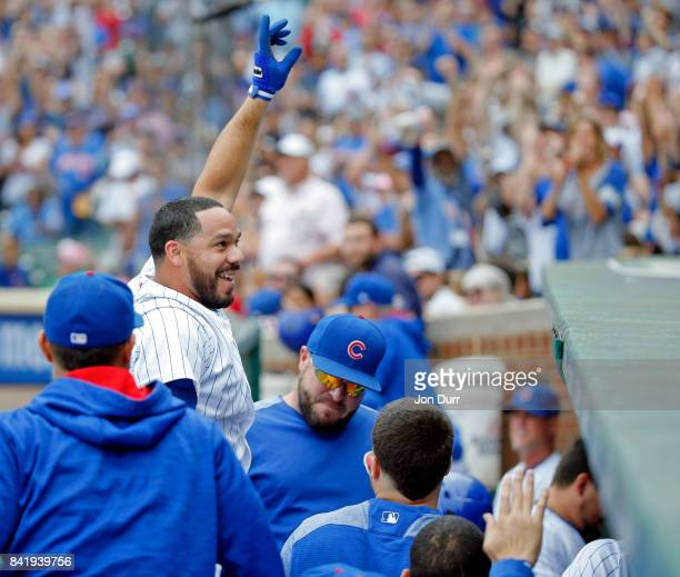 Rene Rivera of the Chicago Cubs gives a curtain call after hitting a grand slam against the Atlanta Braves during the second inning at Wrigley Field...