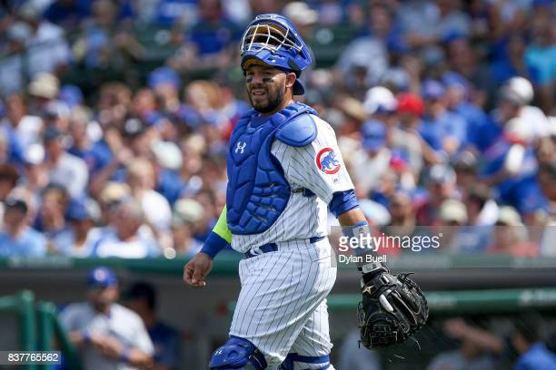 Rene Rivera of the Chicago Cubs walks across the field in the fifth inning against the Toronto Blue Jays at Wrigley Field on August 20 2017 in...