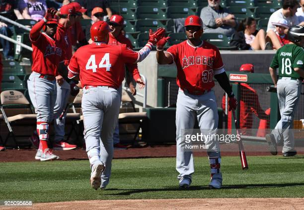 Rene Rivera of the Los Angeles Angels of Anaheim celebrates with teammate Rymer Liriano after hitting a solo home run in the fourth inning against...