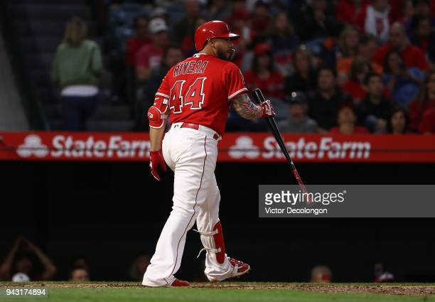 Rene Rivera of the Los Angeles Angels of Anaheim reacts after he struck out swinging in the third inning during the MLB game against the Los Angeles...