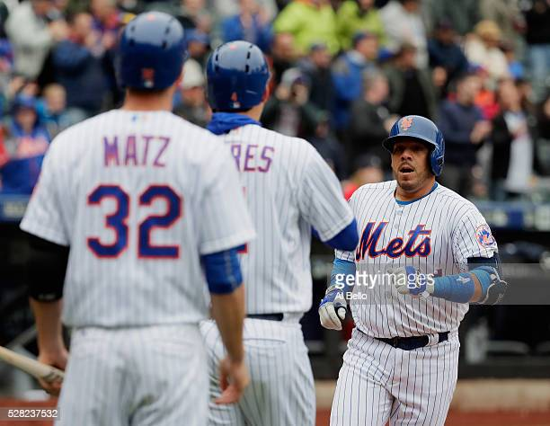 Rene Rivera of the New York Mets celebrates a second inning two run home run with Wilmer Flores and Steven Matz against the Atlanta Braves during...