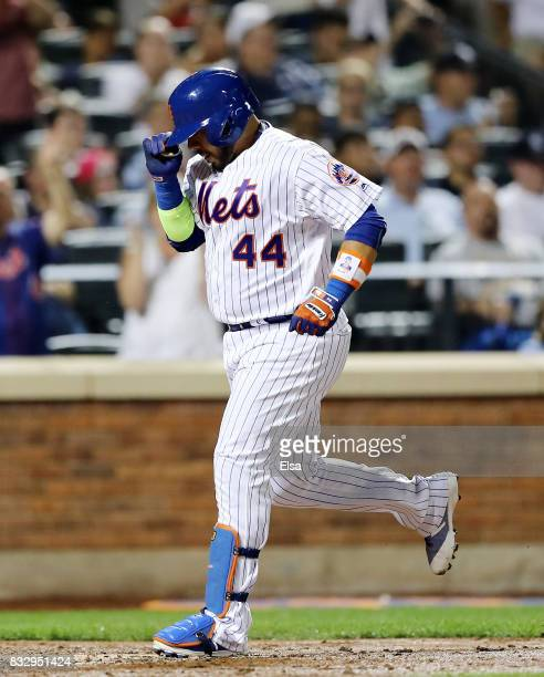 Rene Rivera of the New York Mets celebrates his solo home run in the fifth inning against the New York Yankees during interleague play on August 16...
