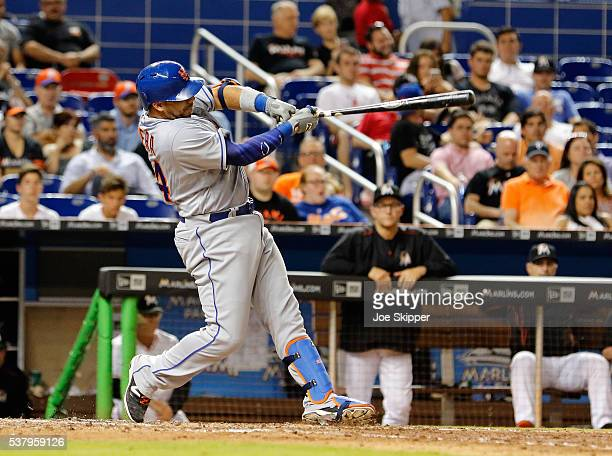 Rene Rivera of the New York Mets hits a ninth inning tworun home run against the Miami Marlins at Marlins Park on June 3 2016 in Miami Florida