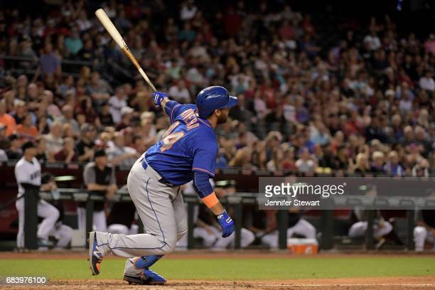 Rene Rivera of the New York Mets hits a tworun home run against the Arizona Diamondbacks during the seventh inning of the MLB game at Chase Field on...