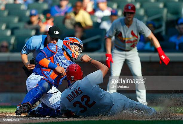 Rene Rivera of the New York Mets tags out Matt Adams of the St Louis Cardinals at home to end the fifth inning at Citi Field on July 26 2016 in the...