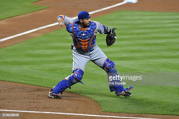 Rene Rivera of the New York Mets throws to first base after a soft ground ball off the bat of Derek Dietrich of the Miami Marlins during the second...