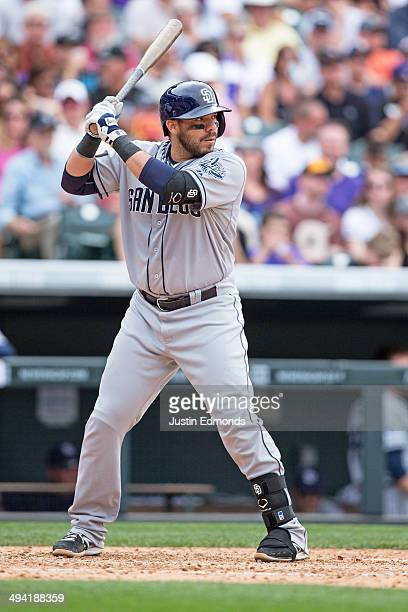 Rene Rivera of the San Diego Padres bats against the Colorado Rockies at Coors Field on May 18 2014 in Denver Colorado The Rockies defeated the...